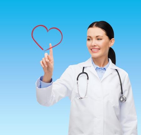 健康、医学、技術コンセプト - 女医の心を指している笑みを浮かべて 写真素材