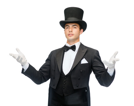 tophat: magic, performance, circus, show concept - magician in top hat showing trick