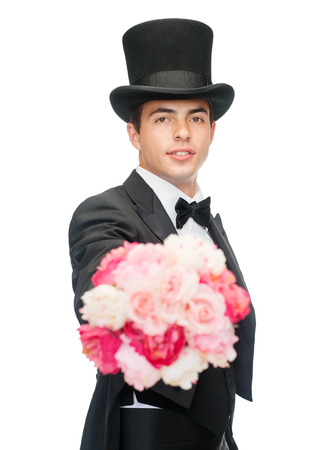 conjuring: magic, performance, circus, show concept - magician with flower bouquet
