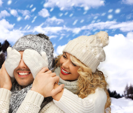 winter holidays, family, vacation and lifestyle concept - family couple in a winter clothes photo