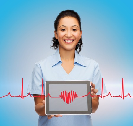 beating: healthcare, medicine and technology concept - smiling african american female doctor or nurse with tablet pc computer