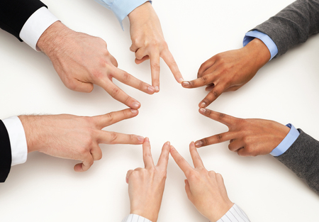 business and succcess concept - group of businesspeople showing v-sign photo