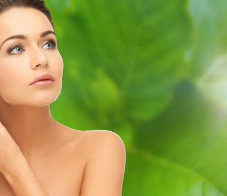 beautiful women: beauty and health concept - face and shoulders of beautiful woman