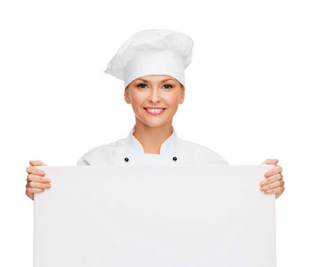 asian cook: cooking, advertisement and food concept - smiling female chef, cook or baker with white blank board Stock Photo
