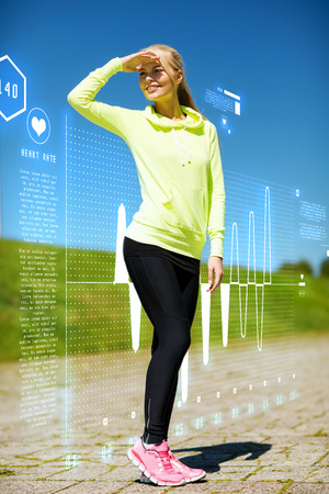heart monitor: fitness and lifestyle concept - woman doing sports outdoors