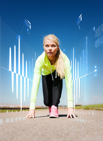 heart monitor: sport and lifestyle concept - concentrated woman doing running outdoors Stock Photo