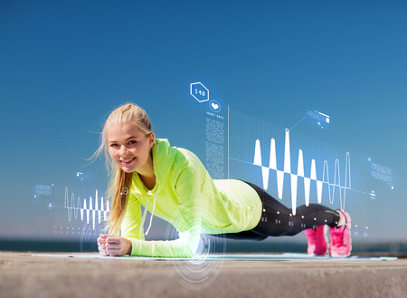 duration: sport and lifestyle concept - woman doing sports outdoors Stock Photo