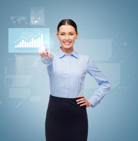 business and education concept - friendly young smiling businesswoman pointing to button photo