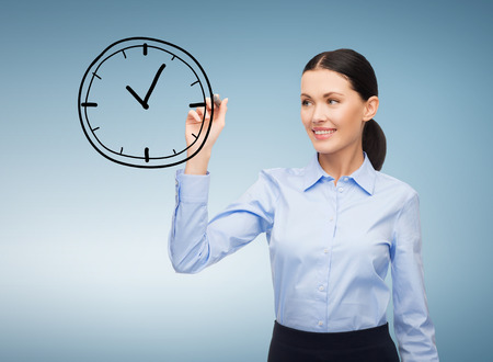 office, business and future technology concept - businesswoman drawing clock in the air with marker