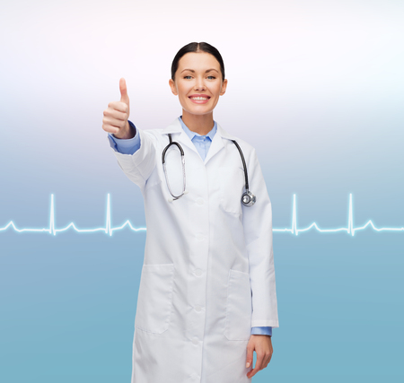 healthcare and medicine concept - smiling female doctor with stethoscope showing thumbs up Stock Photo - 25628674
