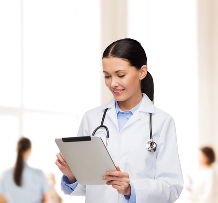 doctor appointment: healthcare, technology and medicine concept - smiling female doctor with stethoscope and tablet pc computer Stock Photo