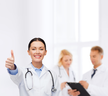 healthcare and medicine concept - smiling female doctor with stethoscope showing thumbs up Stock Photo - 25628861