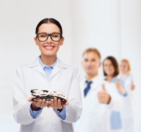 healthcare, vision and medicine concept - smiling female doctor with eyeglasses Stock Photo - 25628865