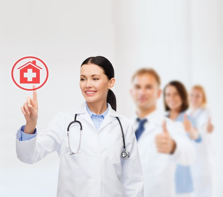 healthcare, medicine and technology concept - smiling female doctor pointing to something or pressing imaginary button Stock Photo - 25628867