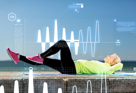 cardio fitness: sport and lifestyle concept - woman doing sports outdoors Stock Photo