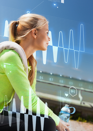resting heart rate: sport, fitness, exercise and lifestyle concept - woman resting after doing sports outdoors