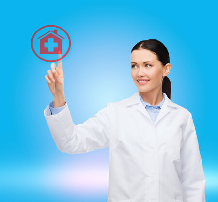 healthcare, medicine and technology concept - smiling female doctor pointing to hospital sign photo