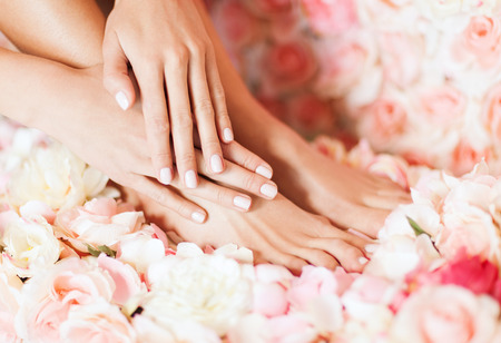 pedicure: beaty and healthcare - closeup of female legs and hand