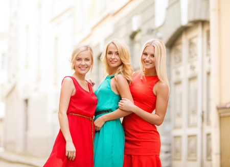 group travel: holidays and tourism, friends, hen party and blonde girls concept - three beautiful women in the city