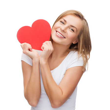 people teenagers: happiness, health and love concept - smiling woman in white t-shirt with heart