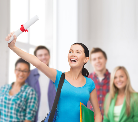 mba: education and happy people concept - smiling student with bag, folders and diploma Stock Photo