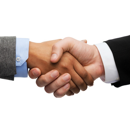 black handshake: business and office concept - businessman and businesswoman shaking hands