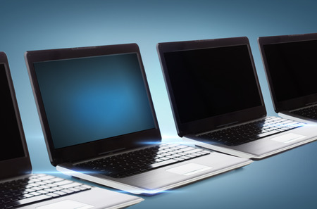 technology and advertisement concept - many laptop computers with blank black screens photo