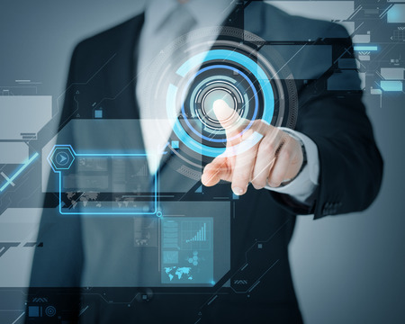 business and future technology concept - man hand pointing at virtual screen
