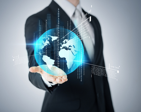 business and future technology concept - closeup of businessmans hand showing earth globe photo