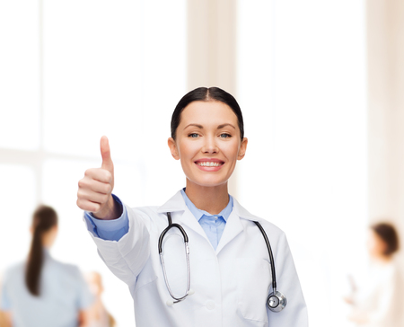 healthcare and medicine concept - smiling female doctor with stethoscope showing thumbs up Stock Photo - 25689884