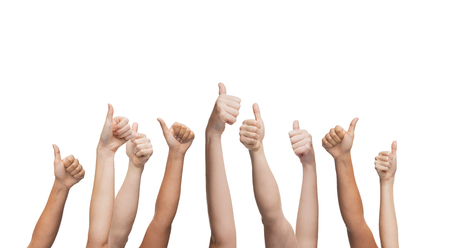 thumbs up group: gesture and body parts concept - human hands showing thumbs up