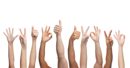 perfect sign: gesture and body parts concept - human hands showing thumbs up, ok and peace signs