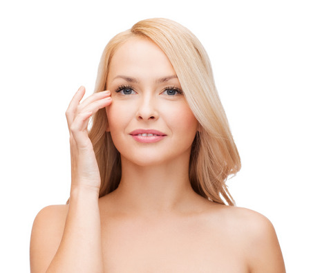 correcting: heath and beauty concept - face of beautiful woman touching her eye area