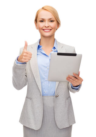 business, internet and technology concept - smiling woman with tablet pc computer showing thumbs up photo