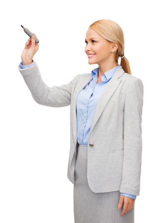 office, business and new technology concept - smiling businesswoman writing something in the air with marker Stock Photo - 25690835
