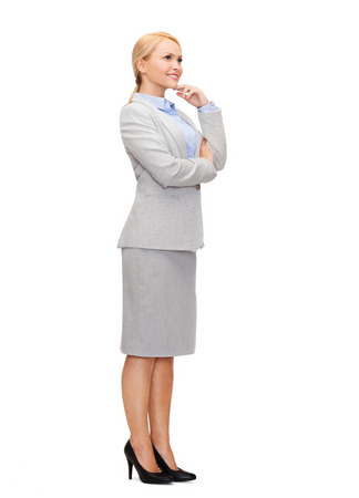 business and education concept - friendly young smiling businesswoman with crossed arms photo