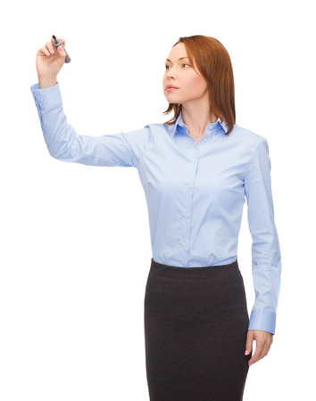 office, business and new technology concept - smiling businesswoman writing something in the air with marker Stock Photo - 25690846