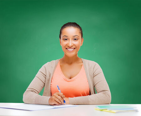 education and business concept - international student studying in college photo