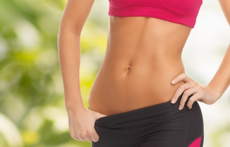trained: fitness and diet concept - close up picture of woman trained abs Stock Photo