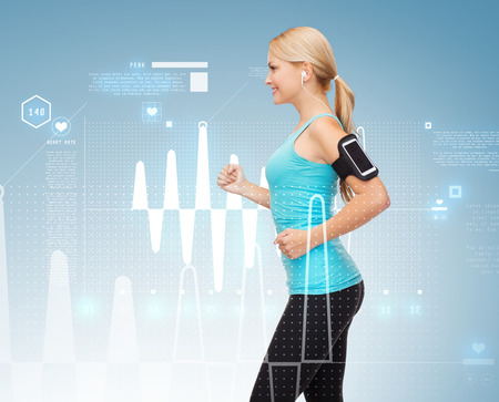 sport, excercise, technology, internet and healthcare - sporty woman running and listening to music from smartphone photo