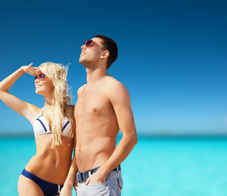 summer holidays and vacation concept - happy couple on the beach photo