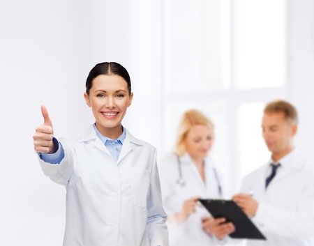 healthcare and medicine concept - smiling female doctor showing thumbs up Stock Photo - 25696926