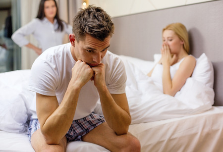 troubles: hotel, travel, relationships and sexual problems concept - wife caught man cheating with another woman