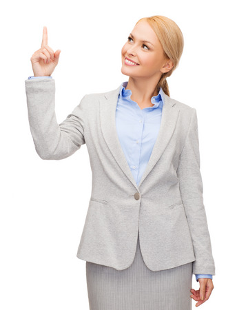 business and education concept - attractive young businesswoman with her finger up looking up photo