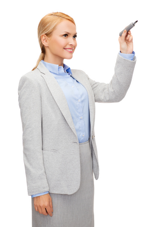 office, business and new technology concept - smiling businesswoman writing something in the air with marker Stock Photo - 25698801