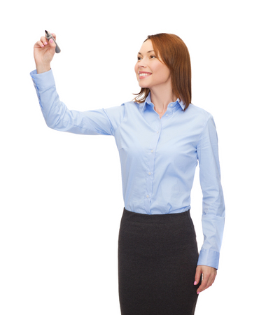 office, business and new technology concept - smiling businesswoman writing something in the air with marker photo