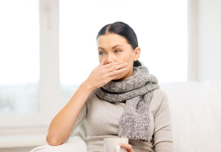 healthcare, home and medicine concept - ill woman with flu at home
