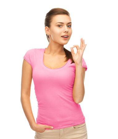 nice breast: clothing design, health and breast cancer awareness concept - smiling girl in blank pink t-shirt showing ok gesture