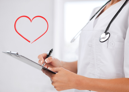 healthcare and medical concept - female doctor with stethoscope writing prescription Stock Photo - 25849820