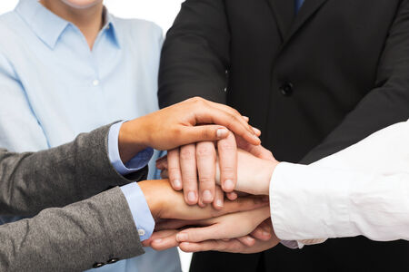 people holding hands: business, succcess and winning concept - group of businesspeople celebrating victory
